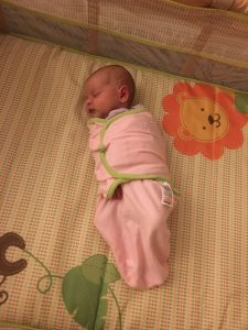 baby in swaddle blanket