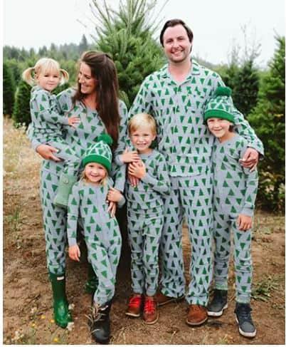 family in Christmas tree pajamas