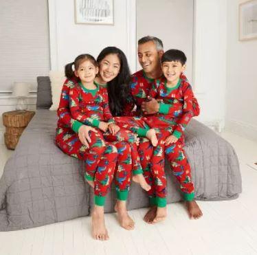 family in dinosaur pajamas