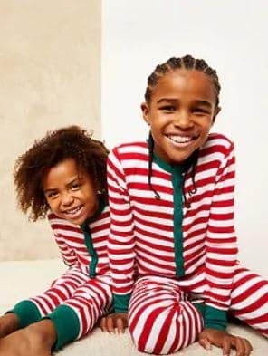 kids in striped Christmas pajamas