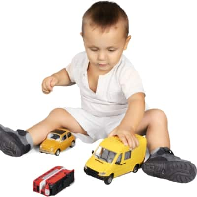 toddler playing with cars