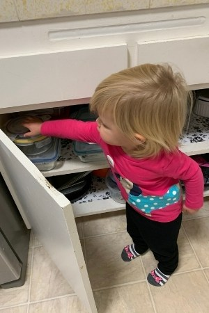 child getting into kitchen cabinets