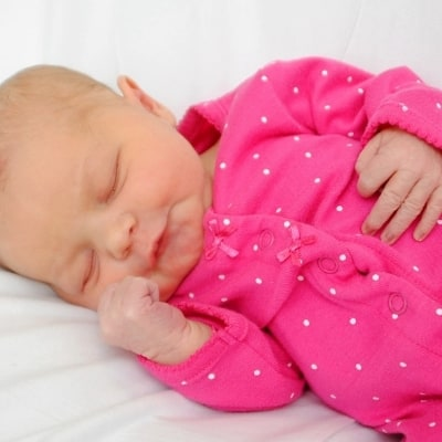newborn baby girl in pink outfit