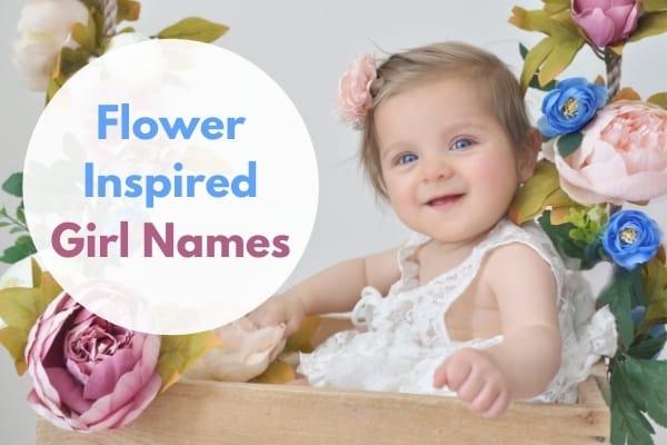 baby girl in flower box